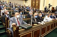 Egyptian parliament members attend a general session in the capital Cairo on July 20, 2020. - Egypt's parliament greenlighted today the possible deployment of troops in Libya to support Cairo's ally Khalifa Haftar, if rival Turkish-backed forces recapture the city of Sirte, the house said. (Photo by - / AFP)