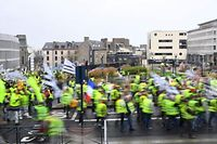 "Yellow Vest (Gilets jaunes) protesters take part in an anti-government demonstration called by the Yellow Vest movement in Saint-Brieuc, western France, on January 12, 2019. - France braced for a fresh round of ""yellow vest"" protests on January 12, 2019 across the country with the authorities vowing zero tolerance for violence after weekly scenes of rioting and vandalism in Paris and other cities over the past two months. (Photo by Damien MEYER / AFP)"