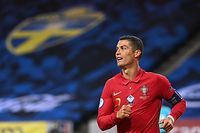 (FILES) This file photo taken on September 8, 2020 shows Portugal's forward Cristiano Ronaldo reacting during the UEFA Nations League football match between Sweden and Portugalin Solna, Sweden. (Photo by Jonathan NACKSTRAND / AFP)