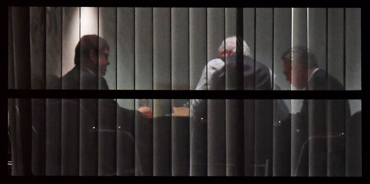 (L-R) Deputy-leader of the Social Democratic Party (SPD), Ralf Stegner, State Premier for the state of Hesse, CDU's Volker Bouffier and German Interior Minister Thomas de Maiziere asre seen through a window during talks between the leaders of the conservative CDU/CSU union and the SPD on forming a new government on January 11, 2018 at the SPD headquarters in Berlin (AFP)
