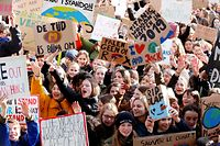"""Youths hold placards and shout slogans during a """"Youth For Climate"""" rally in Leuven, on February 7, 2019, calling on authorities to take action on climate and ecological issues. (Photo by NICOLAS MAETERLINCK / BELGA / AFP) / Belgium OUT"""