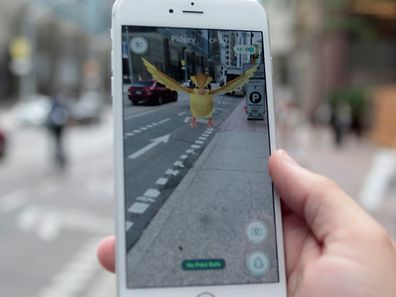 "A ""Pidgey"" Pokemon is seen on the screen of the Pokemon Go mobile app, Nintendo's new scavenger hunt game which utilizes geo-positioning, in a photo illustration taken in downtown Toronto, Ontario, Canada July 11, 2016. REUTERS/Chris Helgren/File Photo"