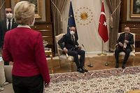 """This video frame grab taken from footage released by The Turkish Presidency on April 6, 2021, shows Turkish President Recep Tayyip Erdogan (R) receiving EU Council President Charles Michel (C) and President of EU Commission Ursula von der Leyen (L) at the Presidential Complex in Ankara. - The European Commission hit out April 7, 2021, at a diplomatic snub that left its head Ursula von der Leyen without a chair as male counterparts sat down at a meeting with Turkish President Recep Tayyip Erdogan. Video from the April 6, 2021, encounter in Ankara showed von der Leyen flummoxed as the Turkish leader and European Council president Charles Michel took the only two chairs in front of their flags. (Photo by - / various sources / AFP) / RESTRICTED TO EDITORIAL USE - MANDATORY CREDIT """"AFP PHOTO /TURKISH PRESIDENTIAL PRESS SERVICE """" - NO MARKETING - NO ADVERTISING CAMPAIGNS - DISTRIBUTED AS A SERVICE TO CLIENTS"""