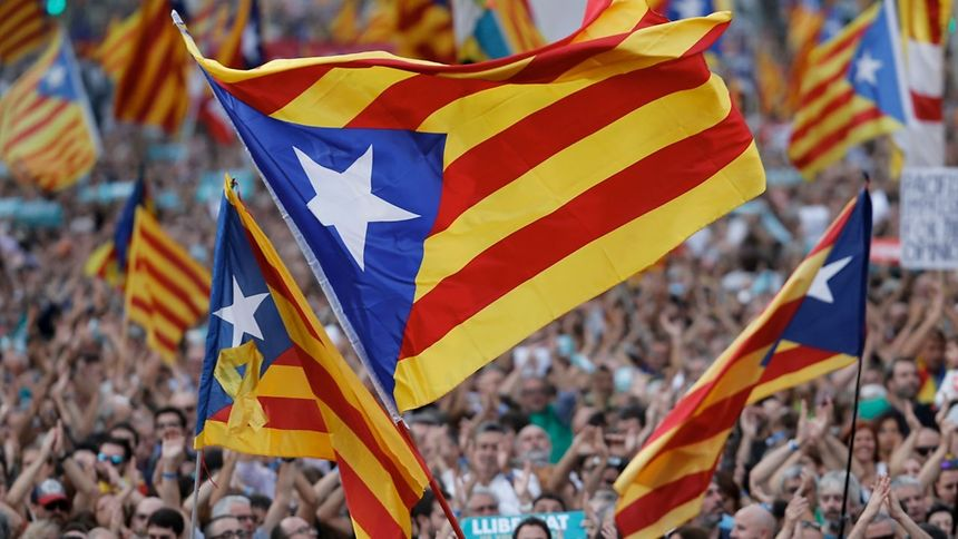 Protesters wave pro-independence Catalan Estelada flags during a demonstration in Barcelona.