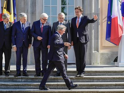 Luxembourg's Foreign minister Jean Asselborn passes by (L to R)Italy's Foreign minister Paolo Gentiloni, Belgium's Foreign minister Didier Reynders, Germany's Foreign minister Frank-Walter Steinmeier, France's Foreign minister Jean-Marc Ayrault and Netherlands' Foreign minister Bert Koenders