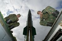 (FILES) Photo taken on October 5, 2005 of Russian soldiers sitting on the launcher of Tochka-M (Point-M), a short range missile, which has a range of about 44 miles (70 kilometres) prior its launch at the military training ground outside the Russian enclave of Kaliningrad. Russia denied that it had made any kind of secret deal with the United States in exchange for Washington shifting its position on missile defence, a foreign ministry spokesman said on September 17, 2009.<br />AFP PHOTO