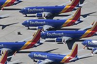 """(FILES) In this file photo taken on March 28, 2019 Southwest Airlines Boeing 737 MAX aircraft are parked on the tarmac after being grounded, at the Southern California Logistics Airport in Victorville, California . - New Boeing Chief Executive David Calhoun told employees on January 13, 2020 the company must strengthen its culture, focus on """"integrity"""" and be """"transparent,"""" according to an email sent to staff. Calhoun, a longtime Boeing board member, officially took over on Monday as chief executive, replacing Dennis Muilenburg, who was ousted in December as the company faces a drawn-out crisis following deadly crashes of a top-selling jet. (Photo by Mark RALSTON / AFP)"""