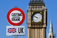 A model of a customs road sign is seen at the mock border of the United Kingdom and the European Union, with a model of Big Ben in the background, during the reopening of the 'Mini-Europe' theme park of small-scale models of European capitals and their landmarks, in Brussels on May 20, 2020. (Photo by JOHN THYS / AFP)