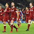 Liverpool's English midfielder Jordan Henderson (2R), Liverpool's Scottish defender Andrew Robertson (R) and Liverpool's Brazilian midfielder Roberto Firmino (L) celebrate after Liverpool's Brazilian midfielder Philippe Coutinho (2L) scored their fourth goal during the English Premier League football match between Brighton and Hove Albion and Liverpool at the American Express Community Stadium in Brighton, southern England on December 2, 2017. / AFP PHOTO / Glyn KIRK / RESTRICTED TO EDITORIAL USE. No use with unauthorized audio, video, data, fixture lists, club/league logos or 'live' services. Online in-match use limited to 75 images, no video emulation. No use in betting, games or single club/league/player publications.  /