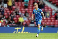 Ukraine's defender Oleksandr Zinchenko celebrates after scoring his team's first goal during the UEFA EURO 2020 round of 16 football match between Sweden and Ukraine at Hampden Park in Glasgow on June 29, 2021. (Photo by Robert Perry / POOL / AFP)
