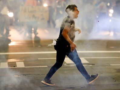 A man is hit with pepper spray paint balls in uptown Charlotte, NC during a protest of the police shooting of Keith Scott, in Charlotte, North Carolina, U.S. September 21, 2016. REUTERS/Jason Miczek     TPX IMAGES OF THE DAY