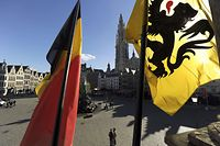 The Belgian (L) and Flemish flag are seen at the town square in Antwerp October 15, 2012, a day after Belgium's municipal elections. The Nieuw-Vlaamse Alliantie (New Flemish Alliance or N-VA) won the most votes in a vast swathe of districts in the Dutch-speaking region of Flanders, including the port city of Antwerp. REUTERS/Laurent Dubrule (BELGIUM - Tags: POLITICS ELECTIONS)