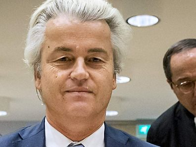 (FILES) This file photo taken on November 23, 2016 at the court of Schiphol, shows Geert Wilders (C) of the Party for Freedom (PVV) sitting upon arrival on the last day of his trial.   The verdict is expected on December 7, 2016 in the case of Wilders, 53, facing charges of insulting a racial group and inciting racial hatred after statements he made about Moroccans living in the Netherlands. / AFP PHOTO / ANP / Remko de Waal / Netherlands OUT