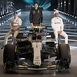 Mercedes AMG Petronas Formula One drivers Finland's Valtteri Bottas (L) and Britain's Lewis Hamilton (R), with Mercedes AMG Petronas Formula One Team Principal and Executive Director, Toto Wolff ,(C), pose on the new 2018 season Mercedes-AMG F1 W09 EQ Power+ Formula One car during its launch at Silverstone motor racing circuit near Towcester, central England on February 22, 2018. / AFP PHOTO / Justin TALLIS