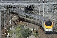 """A Eurostar train arrives in Northern French town Coquelles after coming out the Channel Tunnel on September 13, 2008 as traffic resumes today in fire-hit tunnel between France and Britain with """"a reduced service"""", operator Eurostar announced.  A statement issued in Paris late yesterday said trains would use the south tunnel which was not affected by a 1,000-degree inferno that shut down the busy dual-tunnel link between Britain and mainland Europe on Thursday.  AFP PHOTO PHILIPPE HUGUEN"""