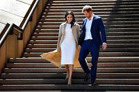 """(FILES) In this file photo taken on October 16, 2018 Britain's Prince Harry and his wife Meghan walk down the stairs of the iconic Opera House in Sydney to meet people. - Prince Harry Meghan Markle announced on June 6, 2021 the birth of their daughter Lilibet Diana, who was born in California after a year of turmoil in Britain's royal family. """"Lili is named after her great-grandmother, Her Majesty The Queen, whose family nickname is Lilibet. Her middle name, Diana, was chosen to honor her beloved late grandmother, The Princess of Wales,"""" said a statement from the couple. (Photo by STR / AFP)"""