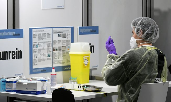 Healthcare worker preparing to administer a vaccine