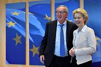 "(FILES) In this file photo taken on July 23, 2019 outgoing president of the European Commission Jean-Claude Juncker (L) welcomes German Defence Minister and newly-appointed EU Commission Chief Ursula von der Leyen, in Brussels. - While others spend August on the beach, EU president-elect Ursula von der Leyen works on the ""delicate"" task of building a team to run the bloc's executive for the next five years. After she was only narrowly approved by the European Parliament, the former German defence minister faces a tricky balancing act. She is trying to accommodate the competing demands of different political parties to make sure her team survives a confirmation vote by MEPs in October. (Photo by JOHN THYS / AFP)"