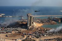 TOPSHOT - A general view shows the damaged grain silos of Beirut's harbour and its surroundings on August 5, 2020, one day after a powerful twin explosion tore through Lebanon's capital, resulting from the ignition of a huge depot of ammonium nitrate at the city's main port. - Rescuers searched for survivors in Beirut after a cataclysmic explosion at the port sowed devastation across entire neighbourhoods, killing more than 100 people, wounding thousands and plunging Lebanon deeper into crisis. The blast, which appeared to have been caused by a fire igniting 2,750 tonnes of ammonium nitrate left unsecured in a warehouse, was felt as far away as Cyprus, some 150 miles (240 kilometres) to the northwest. (Photo by STR / AFP)