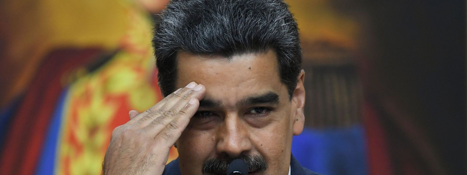 "(FILES) In this file photo taken on February 14, 2020 Venezuela's President Nicolas Maduro gestures during a press conference with members of the foreign media at Miraflores palace in Caracas. - The US Justice Department announced the indictment of Venezuelan President Nicolas Maduro on March 26, 2020 for ""narco-terrorism"" and offered $15 million for information leading to his capture. (Photo by YURI CORTEZ / AFP)"