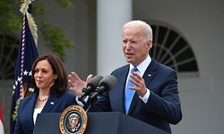 US Vice President Kamala Harris looks on as US President Joe Biden delivers remarks on Covid-19 response and the vaccination program, from the Rose Garden of the White House, Washington, DC on May 13, 2021. (Photo by Nicholas Kamm / AFP)