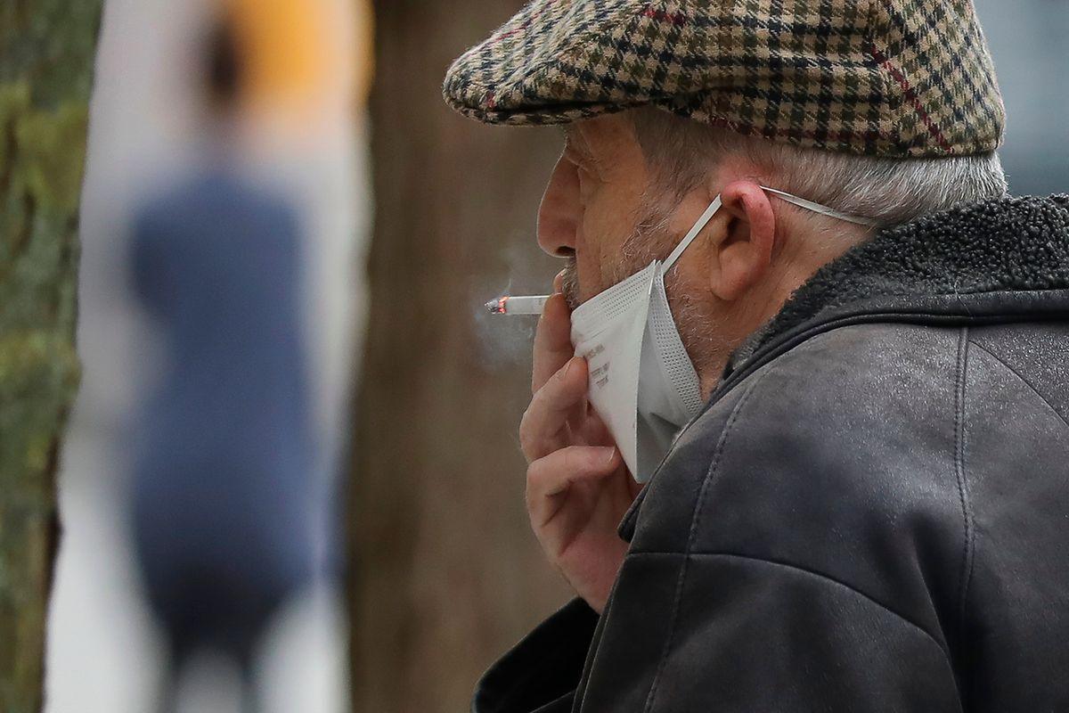 A man smokes a cigarette in Esch-sur-Alzette on Wednesday Photo: Guy Wolff