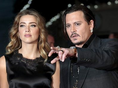 """Cast member Johnny Depp and his actress wife Amber Heard arrive for the premiere of the British film """"Black Mass"""" in London, Britain October 11, 2015. REUTERS/Suzanne Plunkett/Files     TPX IMAGES OF THE DAY"""