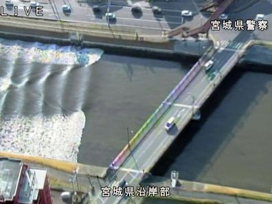 A tidal surge is seen in Sunaoshi River after tsunami advisories were issued following an earthquake in Tagajo, Miyagi prefecture, Japan November 22, 2016, in this video grab image released by Miyagi Prefectural Police via Kyodo. Mandatory credit Miyagi Prefectural Police/Kyodo/via REUTERSATTENTION EDITORS - THIS IMAGE WAS PROVIDED BY A THIRD PARTY. EDITORIAL USE ONLY. MANDATORY CREDIT. JAPAN OUT. NO COMMERCIAL OR EDITORIAL SALES IN JAPAN.