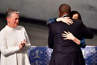 Congolese gynecologist and co-laureate of the 2018 Nobel Peace Prize Denis Mukwege (C) is hugged by Iraqi Yazidi-Kurdish human rights activist and co-laureate of the 2018 Nobel Peace Prize Nadia Murad (R) and applauded by Chairman of the Norwegian Nobel Committee Berit Reiss-Andersen (L) after giving his lecture during the Nobel Peace Prize ceremony 2018 on December 10, 2018 at the City Hall in Oslo, Norway. (Photo by Tobias SCHWARZ / AFP)
