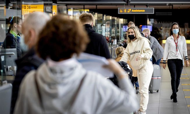 Holidaymakers lined up at Schiphol airport in Amsterdam on Saturday