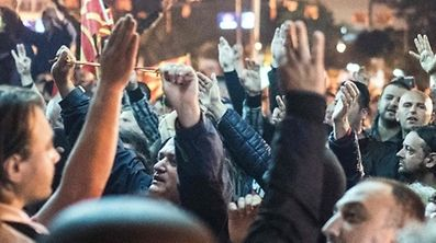 Police face protesters gathered outside Macedonia's parliament after the governing Social Democrats and ethnic Albanian parties voted to elect an Albanian as parliament speaker in Skopje on April 27, 2017.  Macedonia's opposition leader was among at least 10 people injured in parliament on April 27 after protesters stormed the building following an allegedly unfair vote for a parliamentary speaker, witnesses and local media reported. The violence erupted after around 100 protesters supporting the rival VMRO-DPMNE party entered parliament waving Macedonian flags and singing the national anthem.  / AFP PHOTO / Robert ATANASOVSKI
