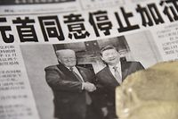 "A newspaper featuring a front page story about the meeting between US President Donald Trump and Chinese President Xi Jinping as seen at a news stand in Beijing on December 3, 2018. - The headline says the two leaders agreed not to increase tarrifs. China's state-run media hailed the trade war truce with the United States as ""momentous"" on December 3 but warned of complex negotiations ahead, even as President Donald Trump said Beijing agreed to cut car tariffs. (Photo by GREG BAKER / AFP)"