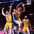 LOS ANGELES, CALIFORNIA - JANUARY 21: Stephen Curry #30 of the Golden State Warriors drives to the basket past Josh Hart #3 and Michael Beasley #11 of the Los Angeles Lakers during the first half at Staples Center on January 21, 2019 in Los Angeles, California. NOTE TO USER: User expressly acknowledges and agrees that, by downloading and or using this photograph, User is consenting to the terms and conditions of the Getty Images License Agreement.   Harry How/Getty Images/AFP == FOR NEWSPAPERS, INTERNET, TELCOS & TELEVISION USE ONLY ==