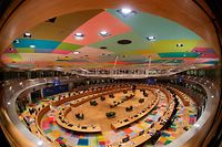 This picture taken with a fisheye lens shows a round table meeting during an EU summit at the European Council building in Brussels, on December 10, 2020. - European Union leaders meet for a year-end summit that will address anything from climate, sanctions against Turkey to budget and virus recovery plans. Brexit will be discussed on the sidelines. (Photo by Olivier HOSLET / POOL / AFP)