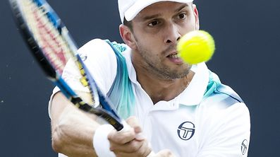 Luxembourg's Gilles Muller (Lux) returns the ball to Croatia's Ivo Karlovic during the  's-Hertogenbosch ATP tennis tournament final match in 's-Hertogenbosch on June 18, 2017.