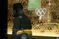 (FILES) In this file photo taken on March 24, 2020, the Olympic rings are displayed at an entrance of the Japan Olympic Museum in Tokyo. - The shock postponement of the Tokyo 2020 Olympics has dealt a savage blow to Japan's hotels and tourism industry already reeling from the impact of the coronavirus pandemic. (Photo by Kazuhiro NOGI / AFP) / To go with AFP story Japan-Oly-Tokyo-economy-tourism-hotels, FOCUS by Kyoko HASEGAWA