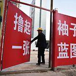 Economia chinesa cresceu em 2019 ao ritmo mais lento em quase 30 anos