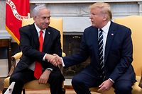US President Donald Trump shakes hands with Israeli Prime Minister Benjamin Netanyahu as they hold a meeting in the Oval Office of the White House in Washington, DC, January 27, 2020. (Photo by SAUL LOEB / AFP)