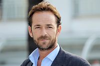 "(FILES) In this file photo taken on October 05, 2010 Actor Luke Perry poses during the TV series photocall ""Goodnight for Justice"" during the 26th edition of the five-day MIPCOM, on October 5, 2010 in Cannes. - Actor Luke Perry, who starred in the hit 1990s television series ""Beverly Hills, 90210,"" died on March 4, 2019 at the age of 52 after suffering a massive stroke, his agent said. (Photo by Valery HACHE / AFP)"