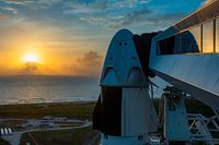 """This handout image released by SpaceX and taken on May 24, 2020 shows a SpaceX Falcon 9 rocket with the company's Crew Dragon spacecraft onboard on the launch pad at NASA's Kennedy Space Center in Florida. - Gray skies loomed over Florida's Atlantic coast on May 26, just one day before two astronauts were set to blast off aboard a SpaceX capsule on the most dangerous and prestigious mission NASA has ever entrusted to a private company. (Photo by - / SPACEX / AFP) / RESTRICTED TO EDITORIAL USE - MANDATORY CREDIT """"AFP PHOTO / SPACEX """" - NO MARKETING - NO ADVERTISING CAMPAIGNS - DISTRIBUTED AS A SERVICE TO CLIENTS"""