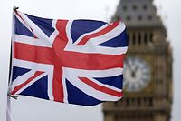 "(FILES) This file photo taken on June 22, 2016 shows A Union flag flies in the wind in front of the Big Ben clock face and the Elizabeth Tower at the Houses of Parliament in central London. Britain's referendum vote to leave the European Union has pitted parents against children, cities against rural areas, north against south and university graduates against those with fewer qualifications. ""What the government is now faced with is not only the economic consequences of a break with the EU, but a fracturing of the United Kingdom,"" said Rodney Barker, emeritus professor of government at the London School of Economics. / AFP PHOTO / JUSTIN TALLIS"