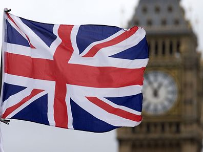 """(FILES) This file photo taken on June 22, 2016 shows A Union flag flies in the wind in front of the Big Ben clock face and the Elizabeth Tower at the Houses of Parliament in central London. Britain's referendum vote to leave the European Union has pitted parents against children, cities against rural areas, north against south and university graduates against those with fewer qualifications. """"What the government is now faced with is not only the economic consequences of a break with the EU, but a fracturing of the United Kingdom,"""" said Rodney Barker, emeritus professor of government at the London School of Economics. / AFP PHOTO / JUSTIN TALLIS"""