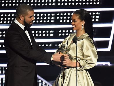NEW YORK, NY - AUGUST 28: Drake presents Rihanna with the The Video Vanguard Award during the 2016 MTV Video Music Awards at Madison Square Garden on August 28, 2016 in New York City.   Michael Loccisano/Getty Images/AFP == FOR NEWSPAPERS, INTERNET, TELCOS & TELEVISION USE ONLY ==