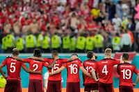 Switzerland's players react after losing  the UEFA EURO 2020 quarter-final football match between Switzerland and Spain at the Saint Petersburg Stadium in Saint Petersburg on July 2, 2021. (Photo by Dmitri Lovetsky / POOL / AFP)