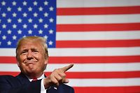 """TOPSHOT - US President Donald Trump speaks during a """"Keep America Great"""" campaign rally at the SNHU Arena in Manchester, New Hampshire, on August 15, 2019. (Photo by Nicholas Kamm / AFP) / ALTERNATIVE CROP"""