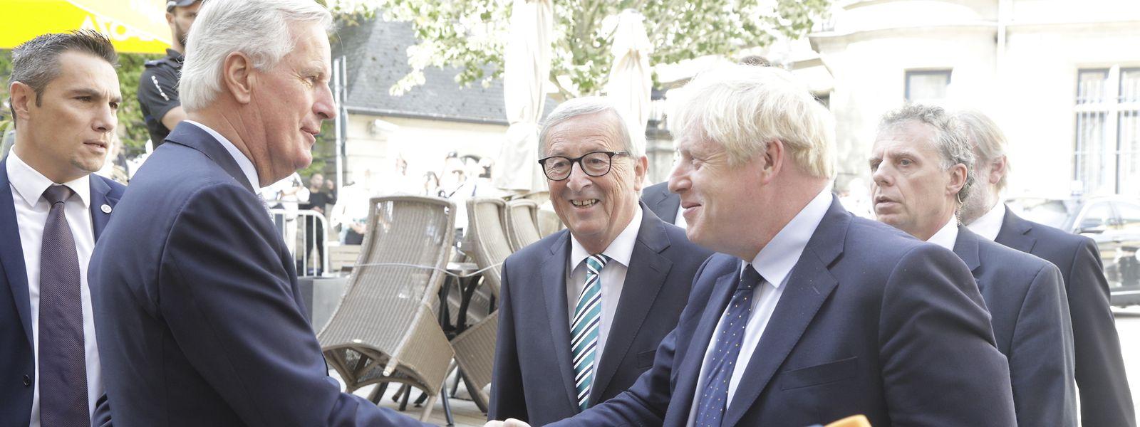 Michel Barnier, Jean-Claude Juncker und Boris Johnson in Luxemburg.