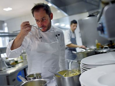 French chef Alexandre Couillon works in the kitchen of his restaurant La Marine in Noirmoutier-en-l'Ile, western France