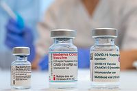 Used vaccine vials that contained (L-R) Pfizer-BioNTech, Moderna and AstraZeneca Covid-19 vaccines are pictured at the Skane University Hospital vaccination centre in Malmo, Sweden, on February 17, 2021. (Photo by Johan NILSSON / TT NEWS AGENCY / AFP) / Sweden OUT
