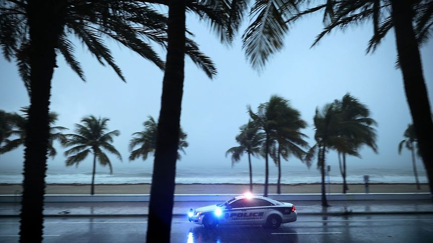 Police patrol the street running along Sebastian Street Beach ahead of the arrival of Hurricane Irma September 9, 2017 in Fort Lauderdale, Florida.