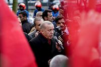 Turkish President Recep Tayyip Erdogan gives a speech as he arrives for a meeting at Permanent Representation of Turkey to the European Union in Brussels on March 9, 2020. - EU chiefs meet Turkey's President Recep Tayyip Erdogan on March 9, 2020 to warn him not to trigger a renewed migrant crisis on their southeastern border, as member states offered to take in some child refugees. (Photo by Kenzo TRIBOUILLARD / AFP)